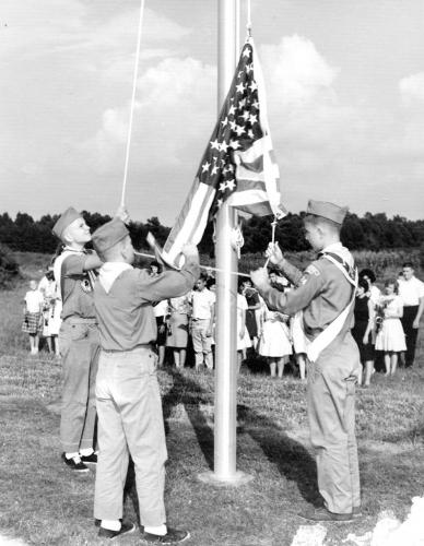 Flag ceremony with boy scouts at one of the new facilities
